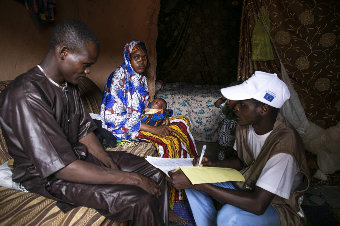 Modou Miko bringing birth certificates to parents in a village in the Maradi region.