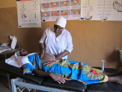 A pregnant woman receiving antenatal care at a primary healthcentre.