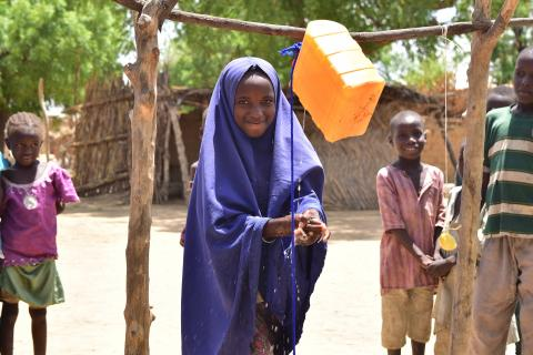 A young girl uses a Tippy Tap in Jigawa State