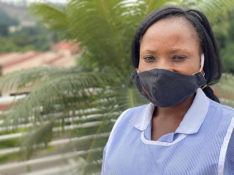 A woman with a face mask