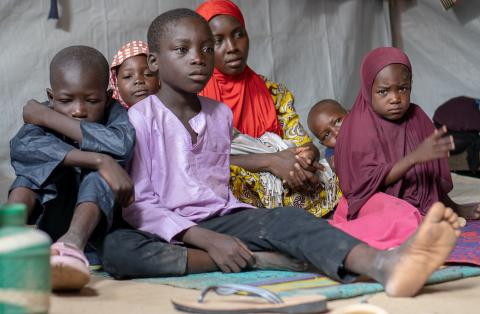 A mother with her children at an IDP camp in Nigeria