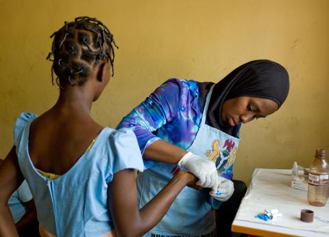 A young girl being tested for HIV