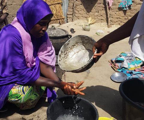 Rehana washes her hands before preparing food for her family in Zabaramari in Borno in north-east Nigeria.