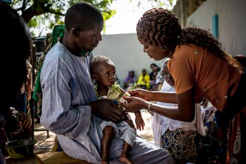 A child being screened for malnutrition