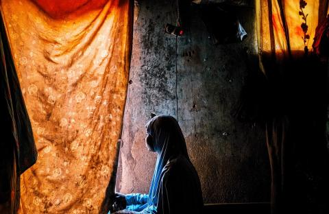 A girl looks out of a window in northeast Nigeria