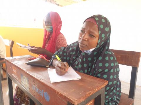 A young lady sitting in a classroom