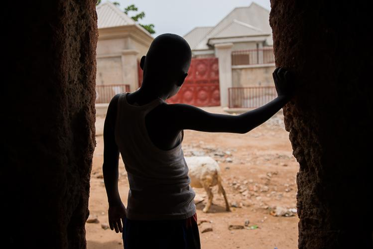 A boy standing in a doorway