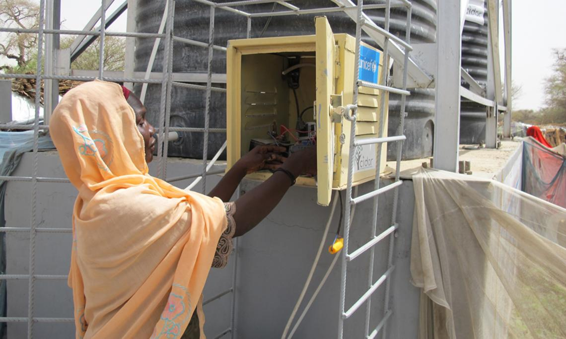 woman-operating-water-supply-equipment