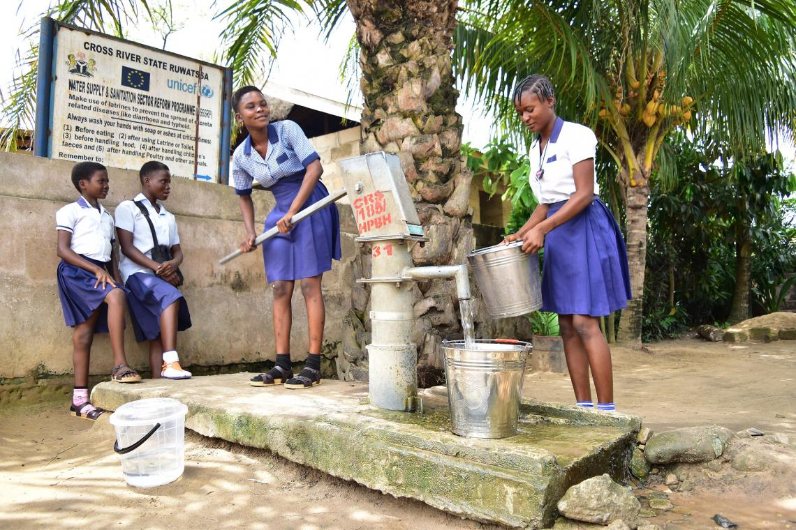 Schoolgirls get safe water from a water facility near their homes