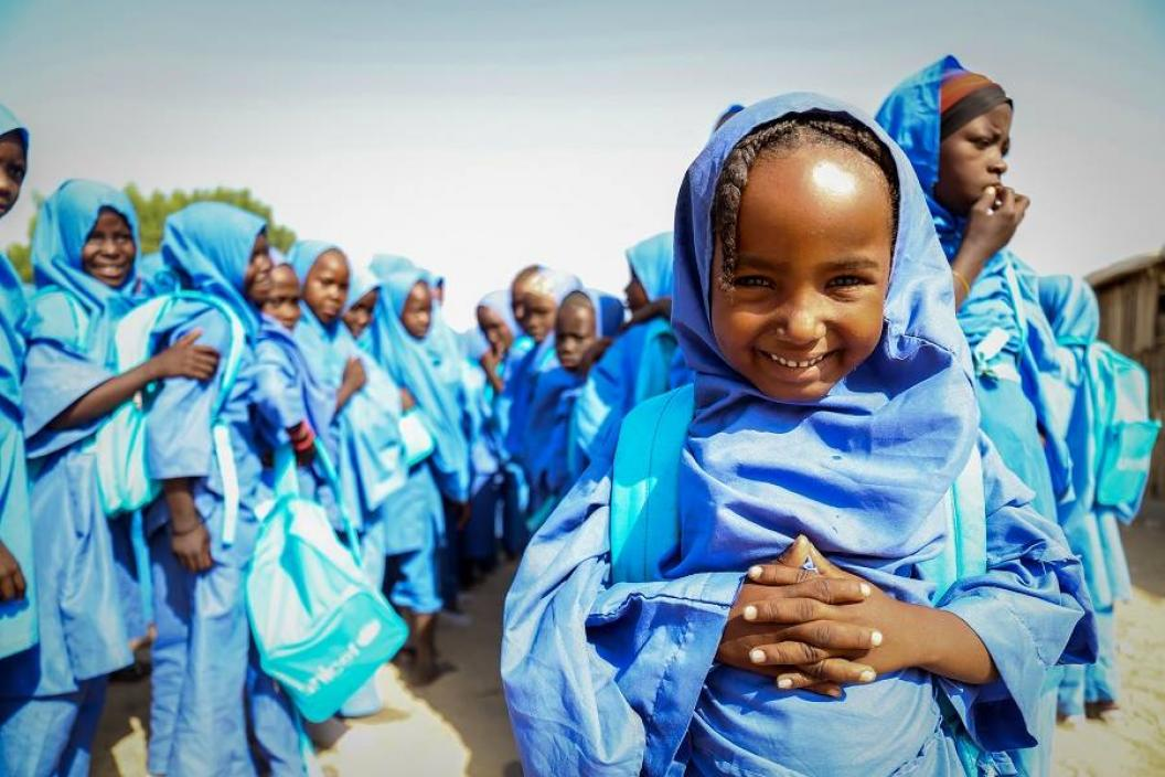 A schoolgirl standing with her schoolmates in Borno State.