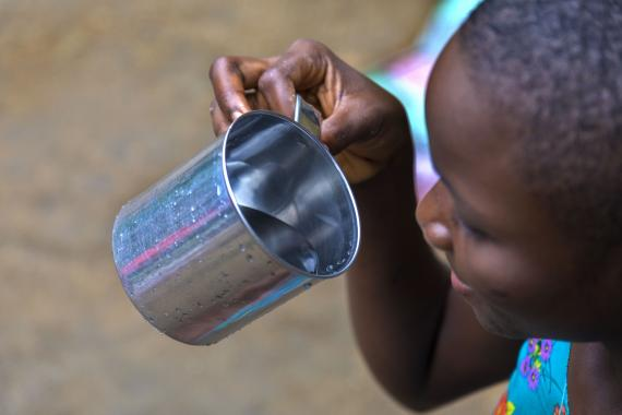 A girl drinking water from a cup
