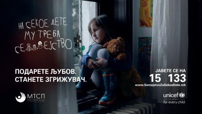 A banner from the campaign with the text every child needs a family over a photo of a young girl sitting on a chair next to a window