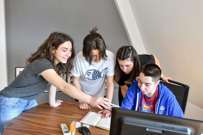 A group of young boys and girls working on project that won the global Generation Unlimited youth challenge