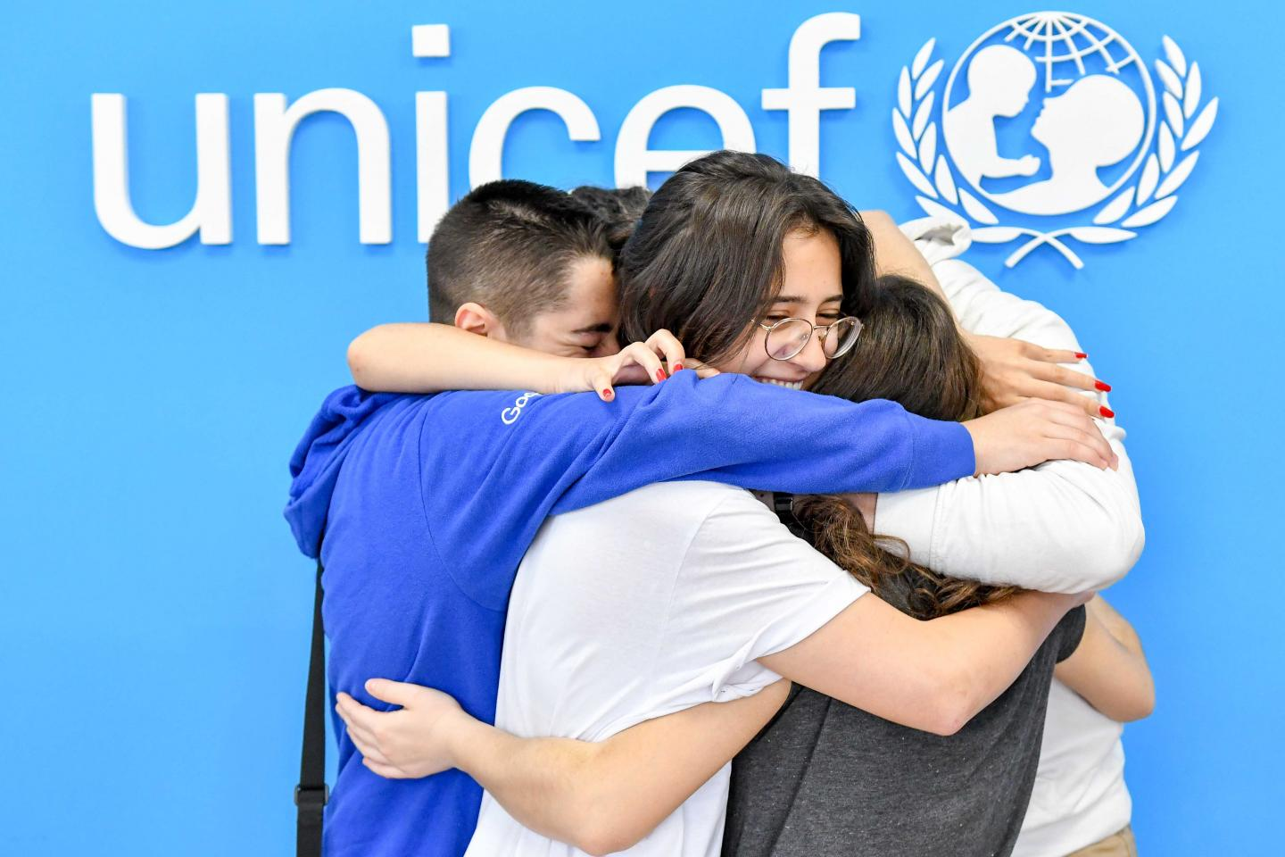Members of the AndroMeta team in a group hug after realizing that they are among the five winners of the global Generation Unlimited challenge