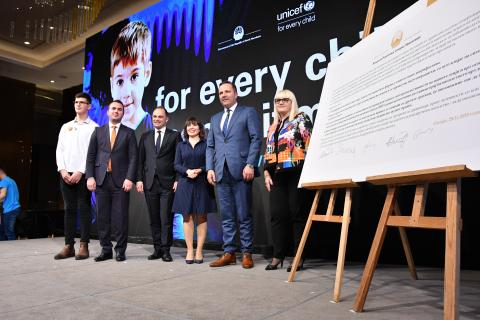 Luka Pavilkevik (15) with Minister of Interior, Mr Spasovski; Minister of Justice, Ms Deskoska; Minister of Health, Dr Filipce; Minister of Education and Science, Mr Ademi; and Minister of Labour and Social Policy, Ms Carovska stand next to the Government pledge to end violence against children