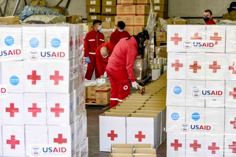 People and packages from UNICEF and the Red Cross