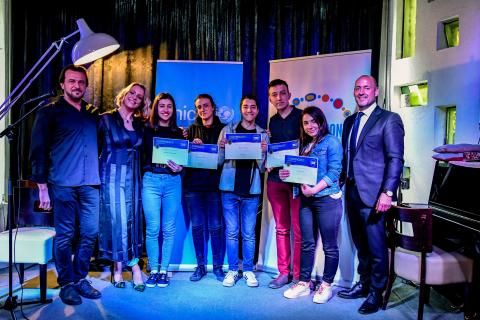 Andrometa - one of the five winning teams of the global Generation Unlimited challenge posing with their certificates along with UNICEF Representative Benjamin Perks, singer Tamara Todevska and one of their mentors