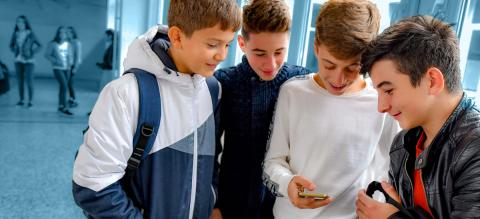Group of boys looking at a phone