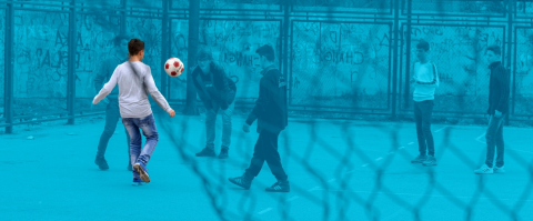 Adolescent boys playing football