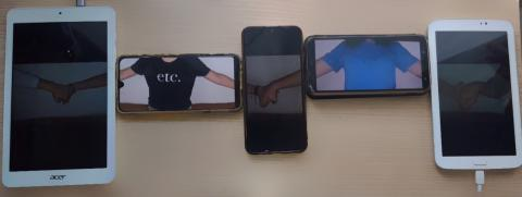 Phones lined up, on the screens we can see hands holding through the screens