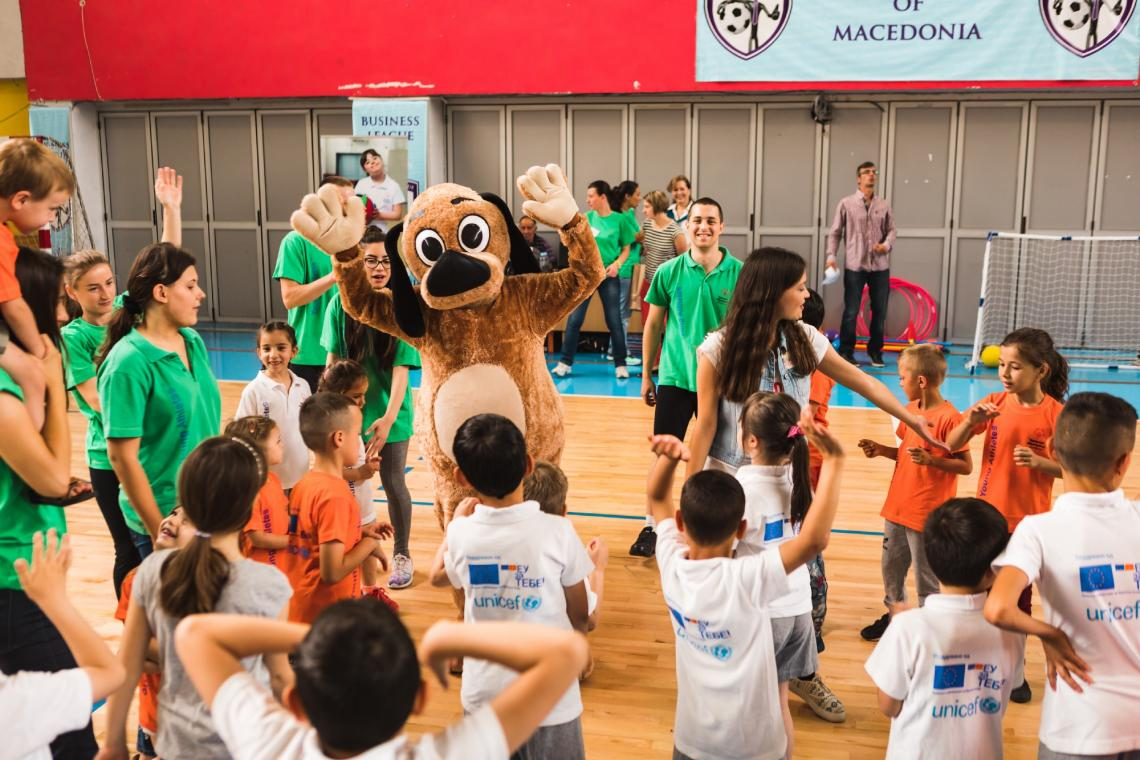 Children jointed by popular children's TV character, Petko sing and dance at the final event of the Young Athletes Programme