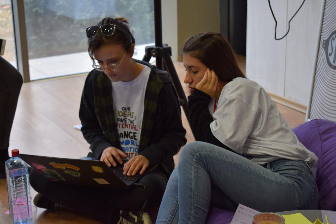 Team members working on the project proposal - on a laptop during the Generation Unlimited workshop in Skopje