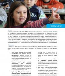 the front page of the publication containing text and a photo of a girl raises her hand in a classroom to answer the question raised by her teacher