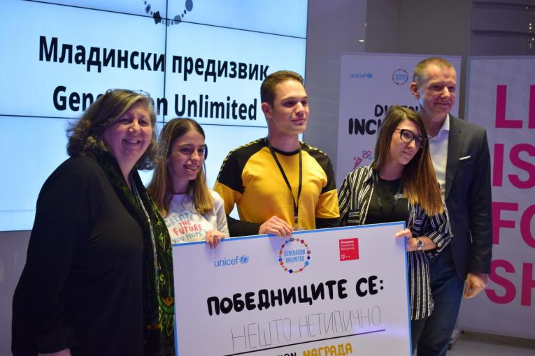 Team of young people with the UNICEF Representative and Telekom CEO