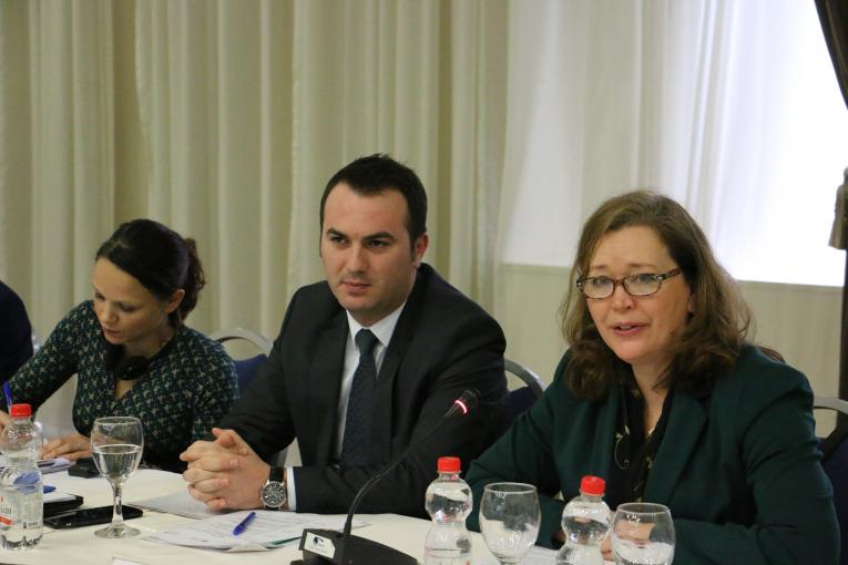 A photo of the minister of education Arber Ademi speaking at the conference. Sitting next to him are Elspeth Erickson, UNICEF deputy representative  and the OECD expert, Hannah Kitchen