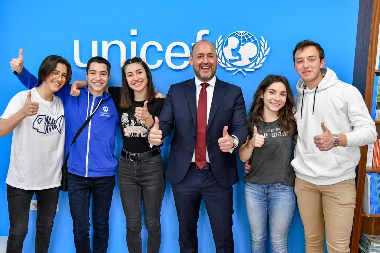 UNICEF representative Benjamin Perks along with the five members of the Andrometa team showing thumbs up after realizing that Andrometa is one of the global winners of the Generation Unlimited challenge.