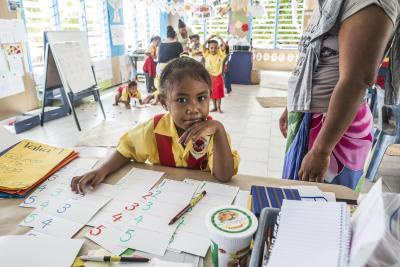 3-year-old Penina, a kindergarten Tialeniu School student, posing for a photograph during class, in Fakaofo Atoll, Tokelau.