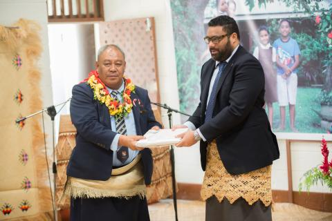 Guest of Honour, Hon. Speaker, Legislative Assembly of Tonga, Lord Fakafanua (right) handing over the MICS results to the Minister for Finance, Hon. Tevita Lavemaau at the official
