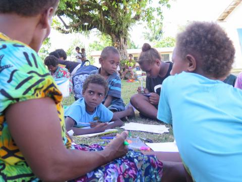 10 year old Castro from Vuigalato Village in Ambae chats with some of his friends at an early childhood space at an evacuation centre in Santo.