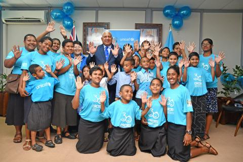 Prime Minister of Fiji, Hon. Josaia Voreqe Bainimarama and children, at the signing of the global pledge to recommit to the Convention on the Rights of the Child