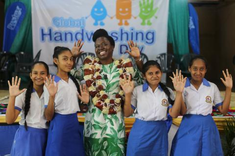 Maria Carmelita Francois UNICEF Pacific WASH Specialist with children who were part of the Global Handwashing Day celebrations.