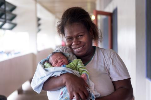 Joana and vilisi at the CMW Post Natal ward. baby Vilis was the first baby born in 2018.