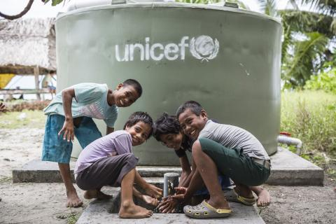 Tabane (9), Takirua (13), Baniti (9) and Mataio (10) washing their hands from a water tank in Taniau Village on Abaiang Atoll. Five water tanks were installed in the village by UNICEF as part of UNICEF supported Kiribati Water and Sanitation program KIRIWATSAN.