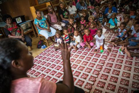 Pre-school children learning at the National Library in Solomon Islands.