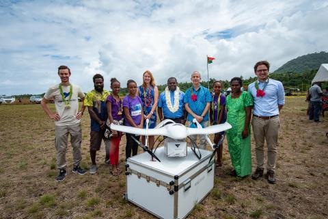 Jack Norris Kalmet Minister of Health Vanuatu with representatives of the drone contractors, nurses Dominc Bule and Roslinda Takrawan and children of SMART sistas at the launch of the Vanuatu Drone trails for Vaccine delivery, Efate Island, Vanuatu.