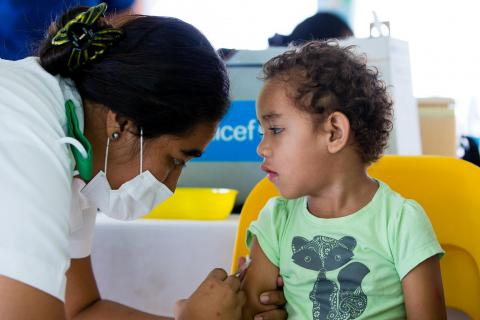 On 2 December 2019, a nurse administers a measles vaccination to three-year-old Josh Vaituliano, in Leauvaa Village, as part of a National Vaccination Campaign in Samoa.