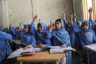 Girl students participating in class