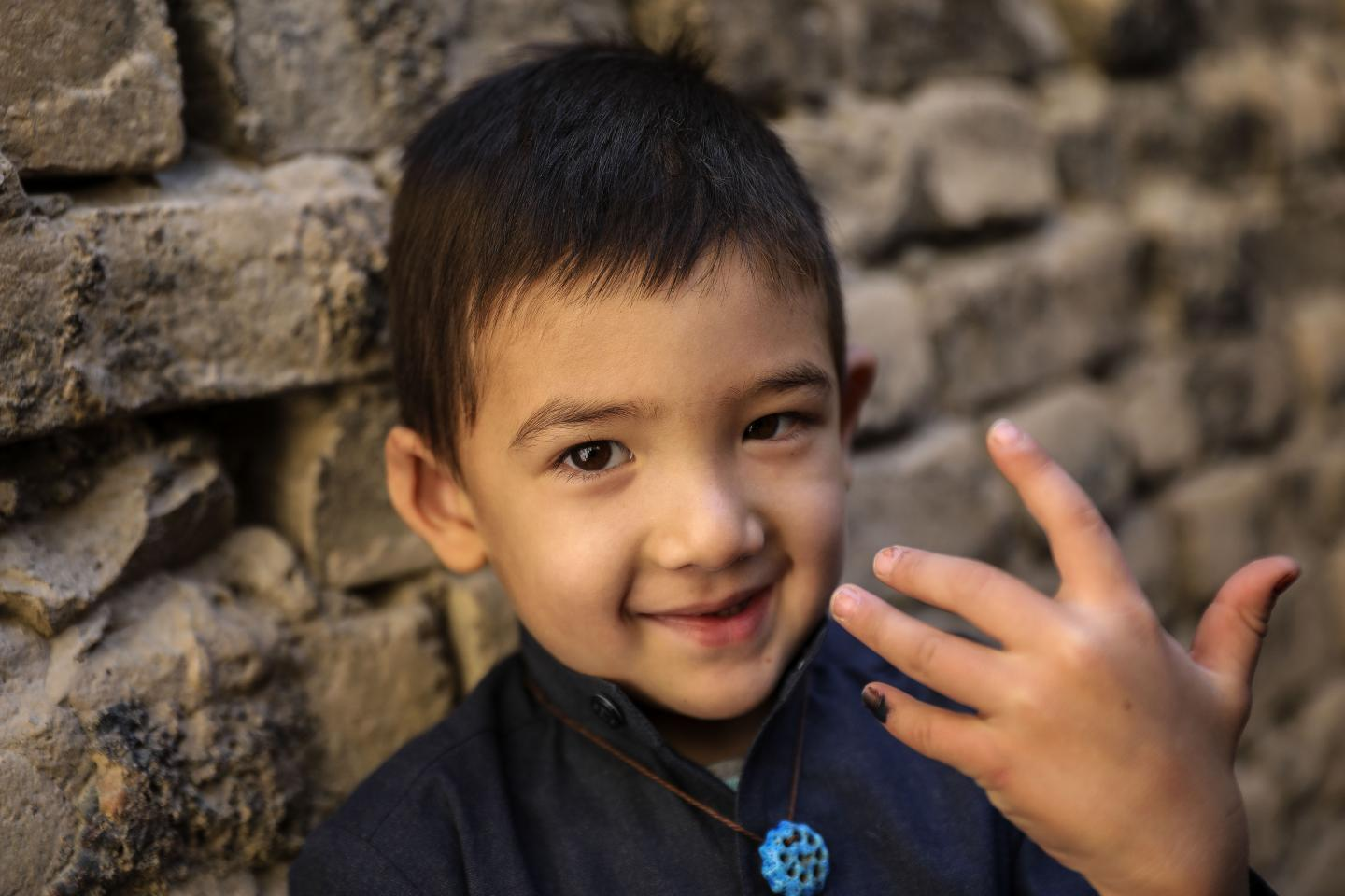 A child shows his finger marked with ink after having been vaccinated against the deadly measles virus in Pakistan.
