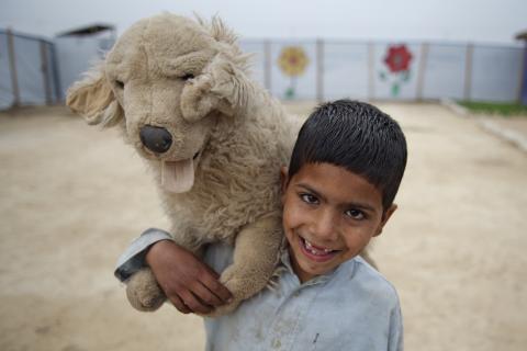5 year old Daniyal plays with a stuff toy in Jalozai Camp, KPK province in Pakistan