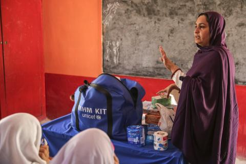 A teacher conducting a menstrual hygiene training session in a school for adolescent girls in Pakistan