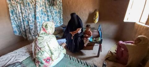 A Lady Health Visitor provides Gulsanga with postnatal  counselling at home.