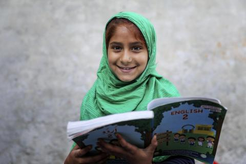 Sunaina smiles while she studies at the AEP Centre.