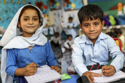 Kahnaiya and Muskan smile in their class room