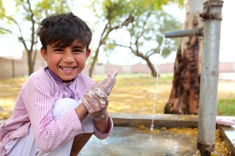 6 year old Amjad washes his hands
