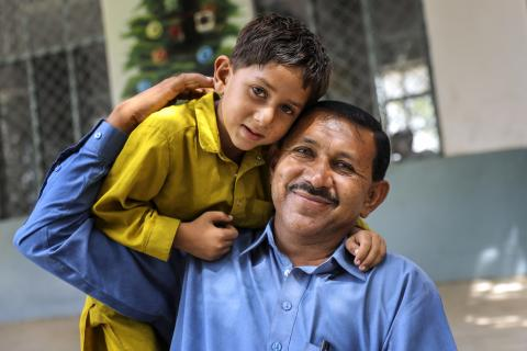 a boy with his father