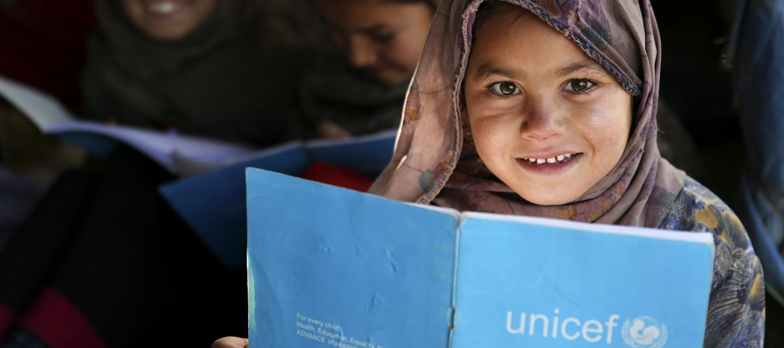 Muharra attends her class in UNICEF supported school in Jalozai camp, KPK